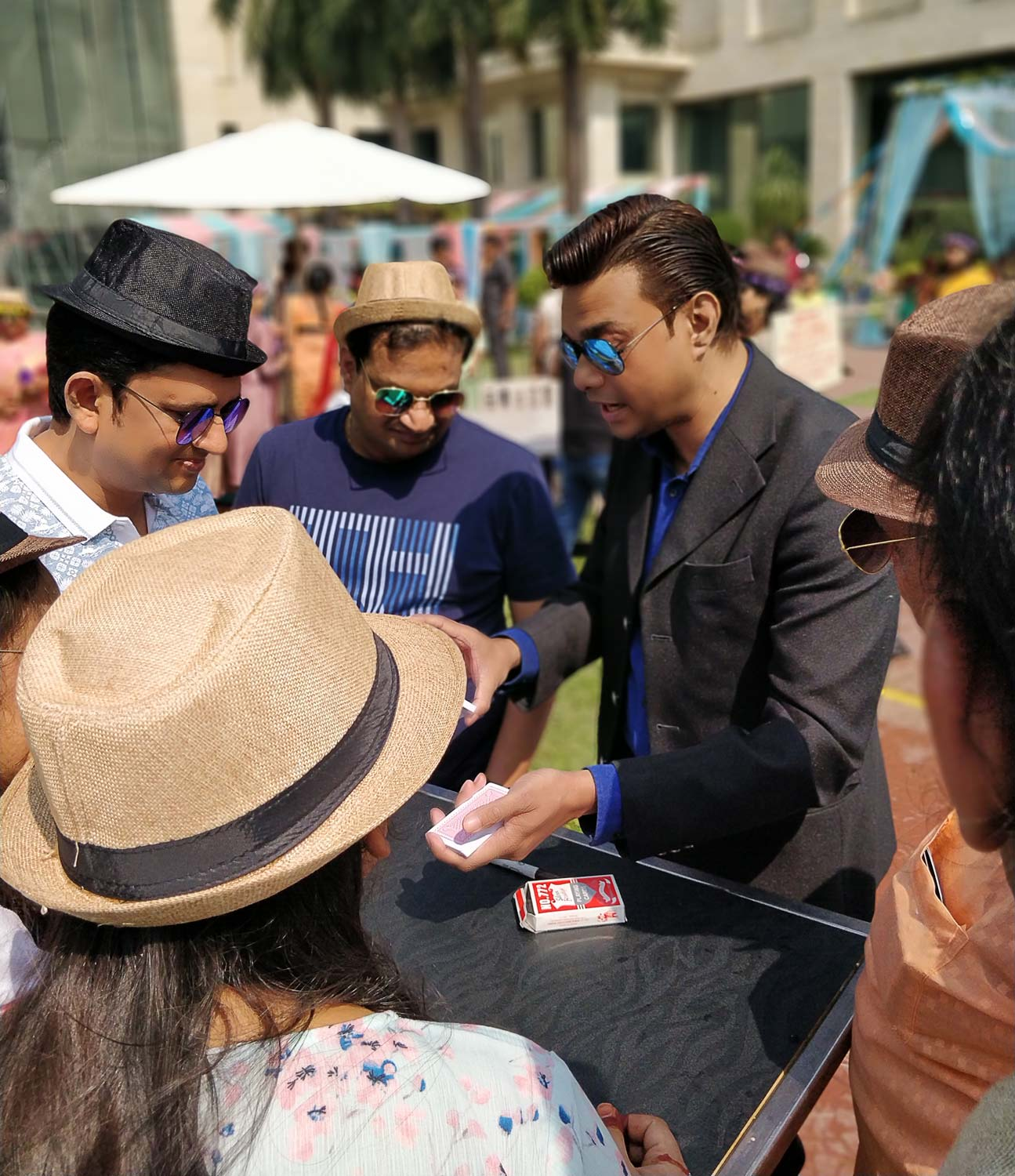 Magician Sourav Burman performing close up intimate illusions at a private event